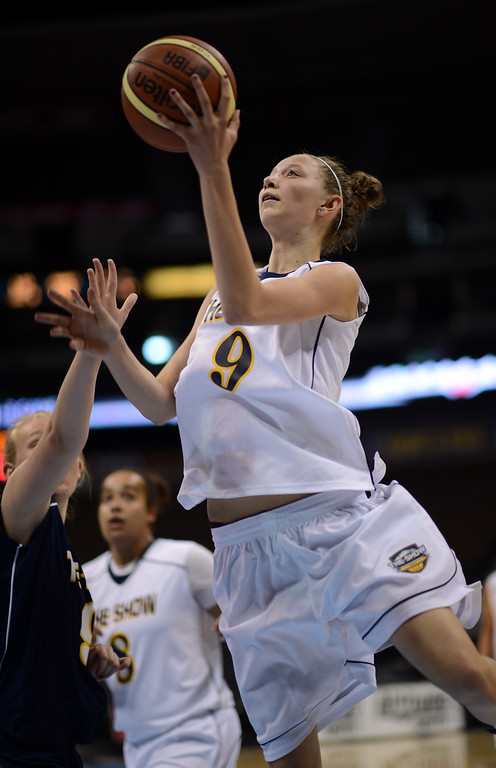 . DENVER, CO. - APRIL 06 : White team Kylee Shook of Mesa Ridge High School (9) controls the ball against Blue team defense during The Show, Colorado\'s High School All-Star game, at Pepsi Center. Denver, Colorado. April 6, 2013. Blue team won 59-51. (Photo By Hyoung Chang/The Denver Post)