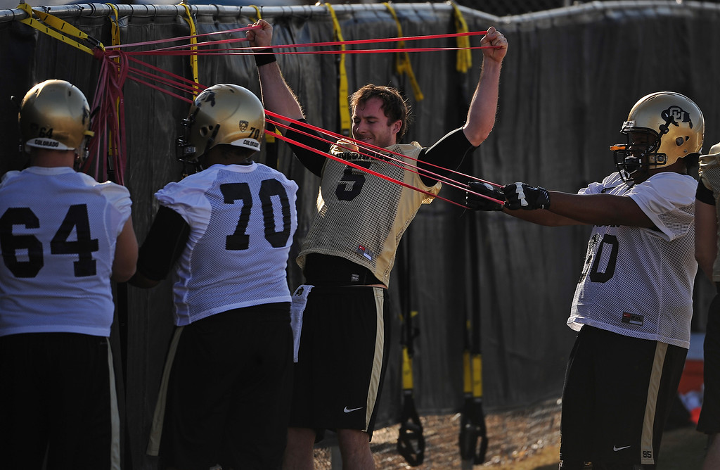 . BOULDER, CO- MARCH 7 : Quarterback Connor Wood, #5, warms up during practice.  The Colorado Buffaloes football team hit the practice field for the first time this season with new head coach Mike MacIntyre in Boulder, CO on March 7, 2013. (Photo By Helen H. Richardson/ The Denver Post)