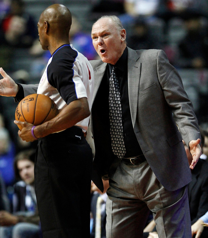 . Denver Nuggets head coach George Karl, right, argues with official Tom Washington after a ball out of bounds was awarded to the Detroit Pistons in the second half of an NBA basketball game, Tuesday, Dec. 11, 2012, in Auburn Hills, Mich. The Nuggets won 101-94. (AP Photo/Duane Burleson)