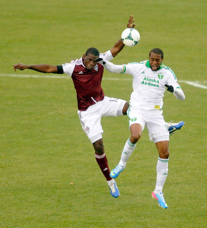 . Hendry Thomas (12) of the Colorado Rapids went for a header with Timbers\' forward Frederic Piquionne (10) in the second half. The Colorado Rapids tied the Portland Timbers 2-2 Saturday, March 30, 2013 at Dick\'s Sporting Goods Park in Commerce City.  Photo By Karl Gehring/The Denver Post)