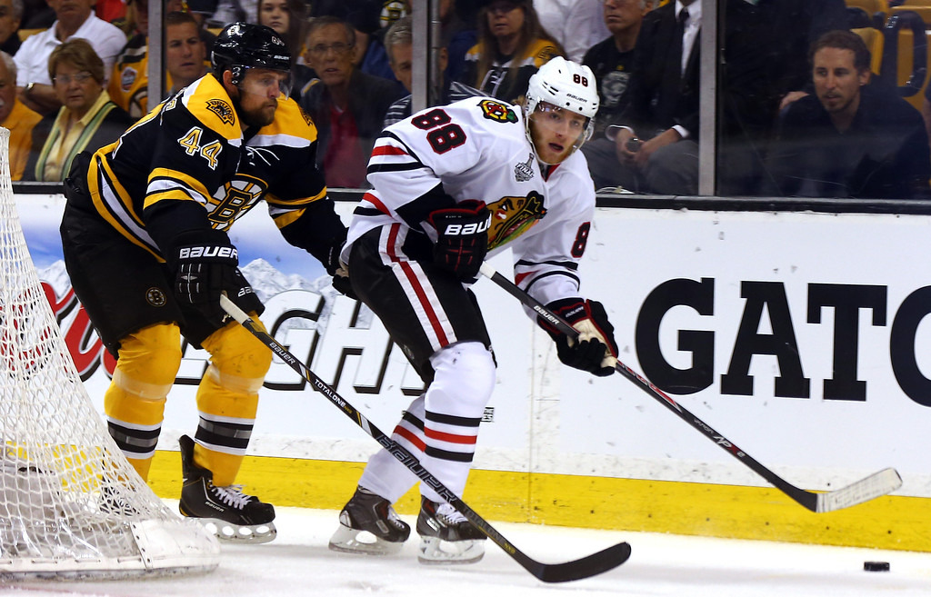 . Patrick Kane #88 of the Chicago Blackhawks handles the puck against Dennis Seidenberg #44 of the Boston Bruins during the first period in Game Four of the 2013 NHL Stanley Cup Final at TD Garden on June 19, 2013 in Boston, Massachusetts.  (Photo by Elsa/Getty Images)