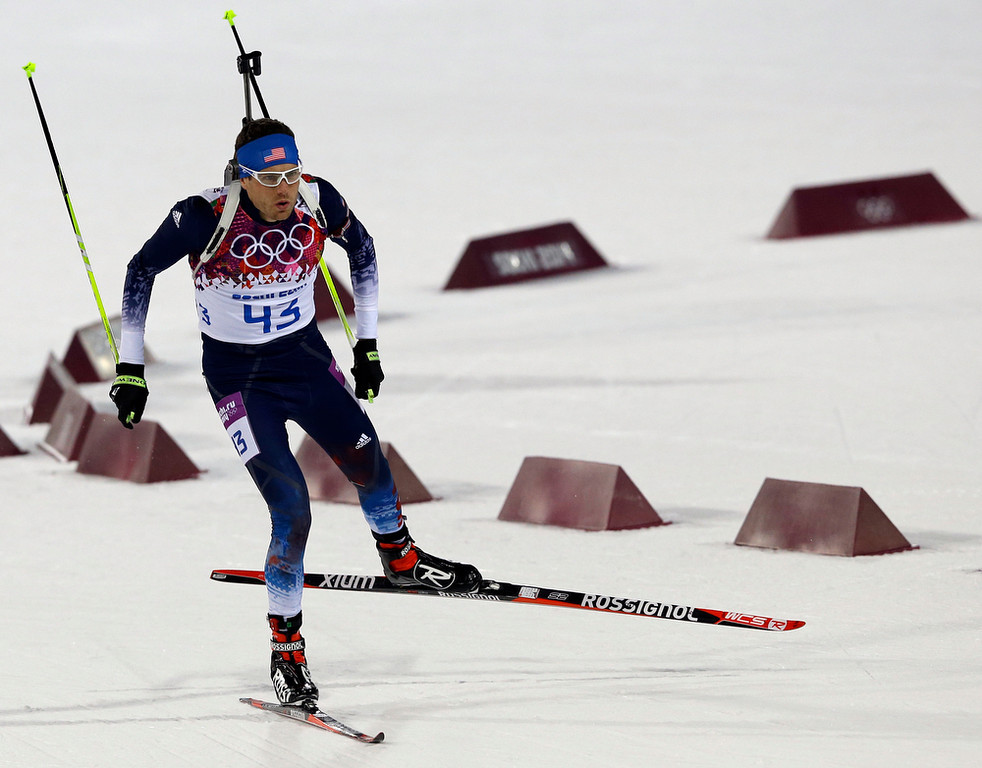 . United States\' Tim Burke competes during the men\'s biathlon 10k sprint, at the 2014 Winter Olympics, Saturday, Feb. 8, 2014, in Krasnaya Polyana, Russia. (AP Photo/Kirsty Wigglesworth)