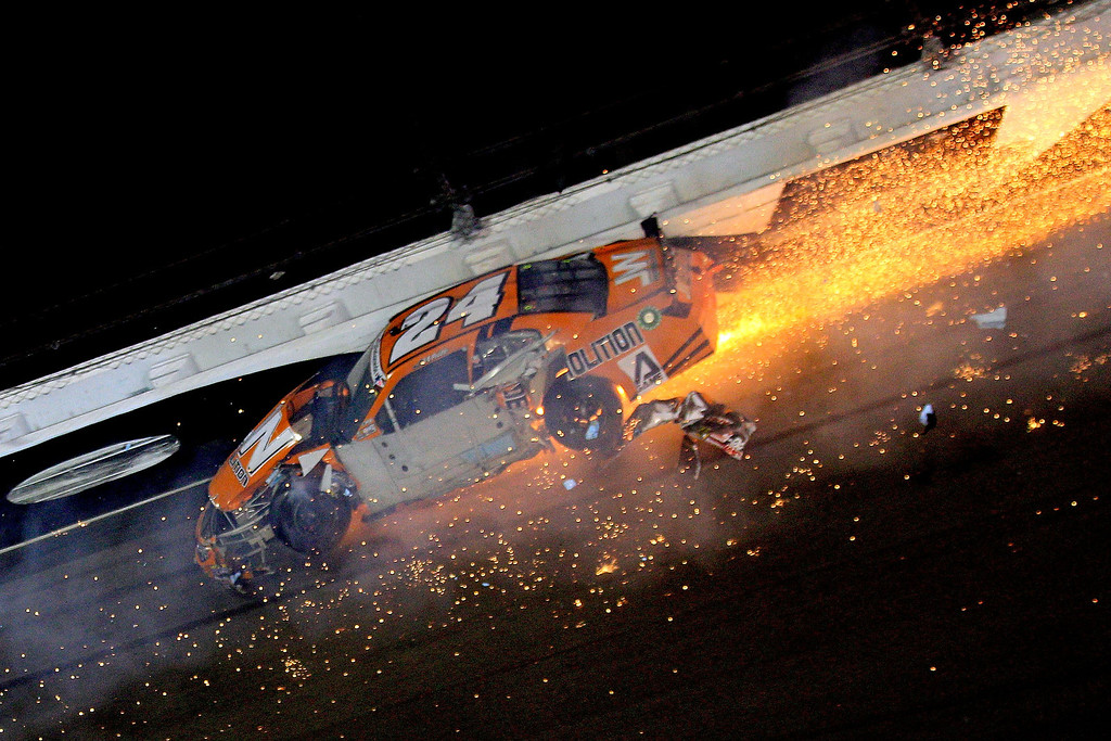 . DAYTONA BEACH, FL - JULY 05:  Jason White , driver of the #24 JW Demolition Toyota, crashes during the NASCAR Nationwide Series Subway Firecracker 250 at Daytona International Speedway on July 5, 2013 in Daytona Beach, Florida.  (Photo by Sean Gardner/Getty Images)