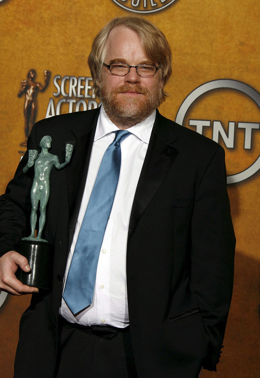 . A file picture dated 29 January 2006 shows US actor Philip Seymour Hoffman holding up his award for best male actor in a leading role in \'Capote\' during the 12th Annual Screen Actors Guild Awards at the Shrine Exposition Center in Los Angeles, California, USA. According to reports on 02 February 2014, Philip Seymour Hoffman was found dead in his apartment in Manhattan, New York, USA. The cause of death has not been determined yet. He was 46.  EPA/PAUL BUCK
