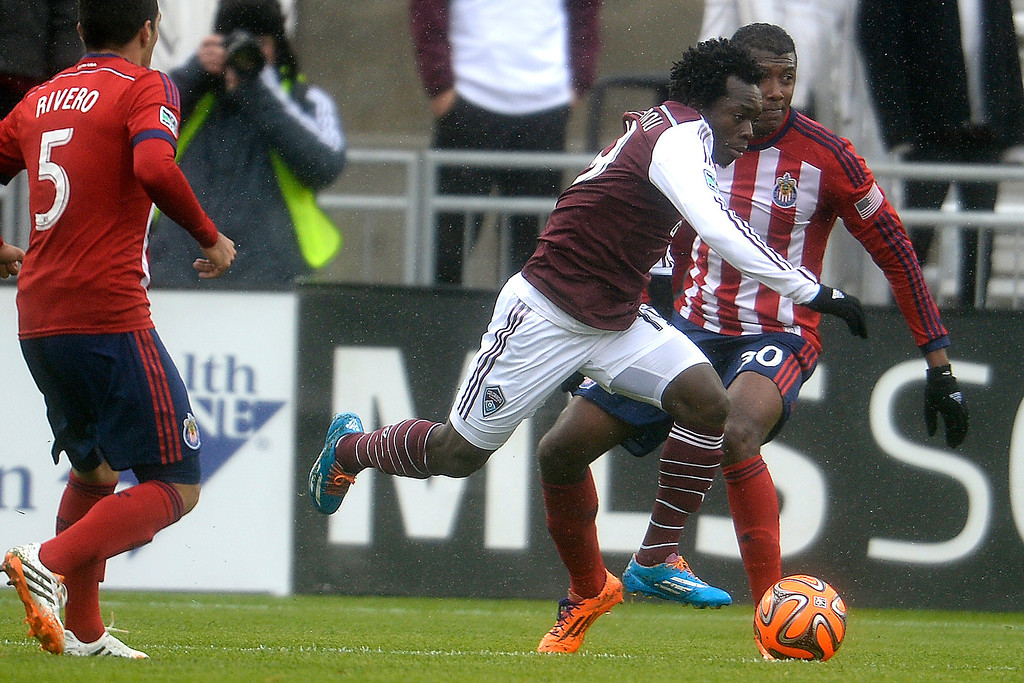 . Charles Eloundou (19) of Colorado Rapids runs past Oswaldo Minda (30) of Chivas USA during the second half. Chivas USA defeated the Colorado Rapids 3-1 on Sunday, May 11, 2014. (Photo by AAron Ontiveroz/The Denver Post)