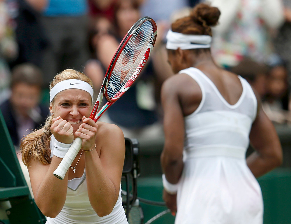 . Sabine Lisicki of Germany (L) celebrates after defeating Serena Williams of the U.S. (R) during their women\'s singles tennis match at the Wimbledon Tennis Championships, in London July 1, 2013.     REUTERS/Eddie Keogh
