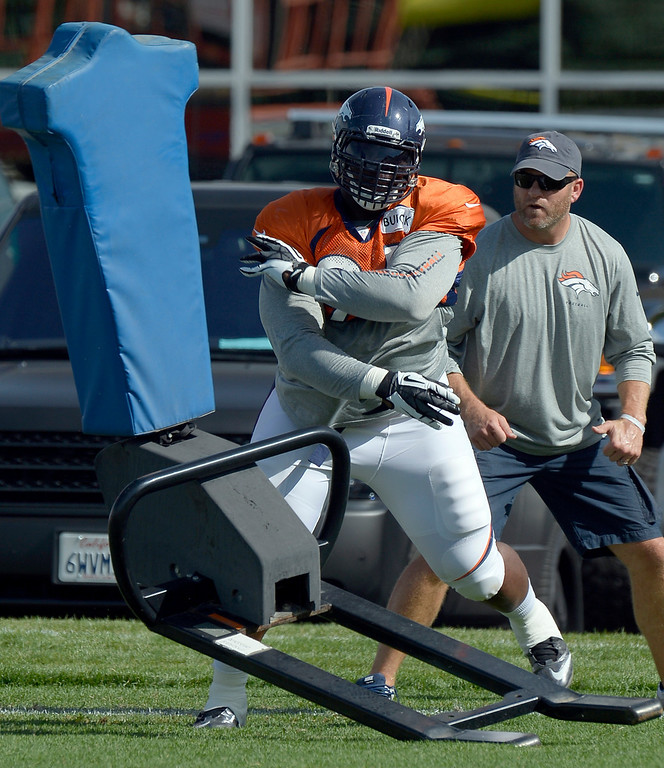 . Denver Broncos DT Terrance Knighton (94) hits the sled during training camp August 6, 2013 at Dove Valley. (Photo By John Leyba/The Denver Post)