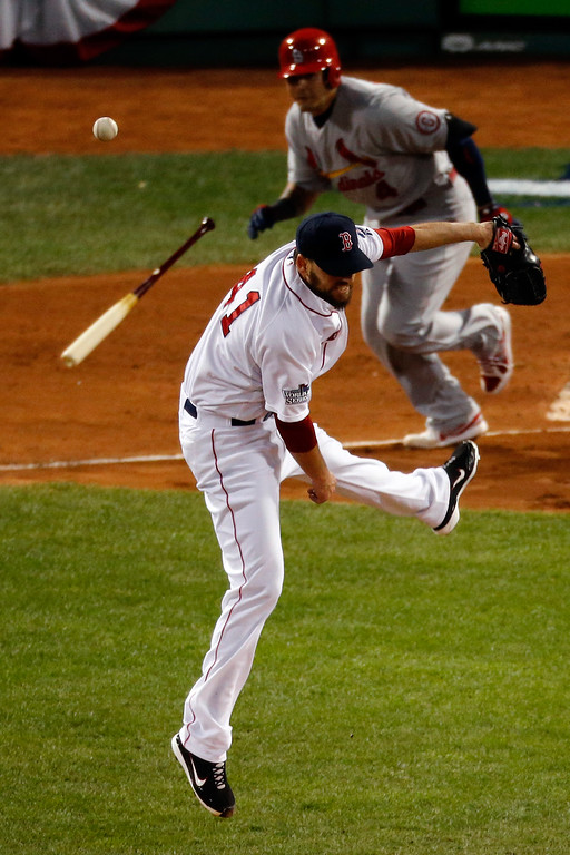 . John Lackey #41 of the Boston Red Sox tries to field a ball hit by Yadier Molina #4 of the St. Louis Cardinals during Game Two of the 2013 World Series at Fenway Park on October 24, 2013 in Boston, Massachusetts.  (Photo by Jim Rogash/Getty Images)