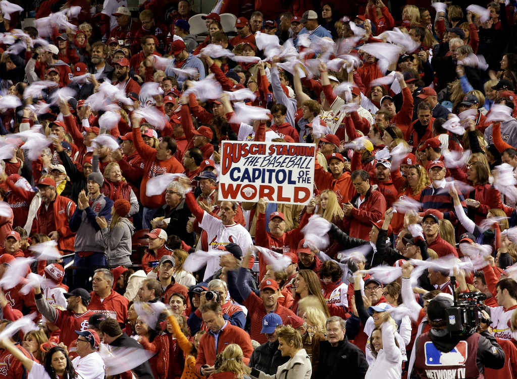 . Fans cheer during the first inning of Game 6 of the National League baseball championship series between the St. Louis Cardinals and the Los Angeles Dodgers Friday, Oct. 18, 2013, in St. Louis. (AP Photo/David J. Phillip)