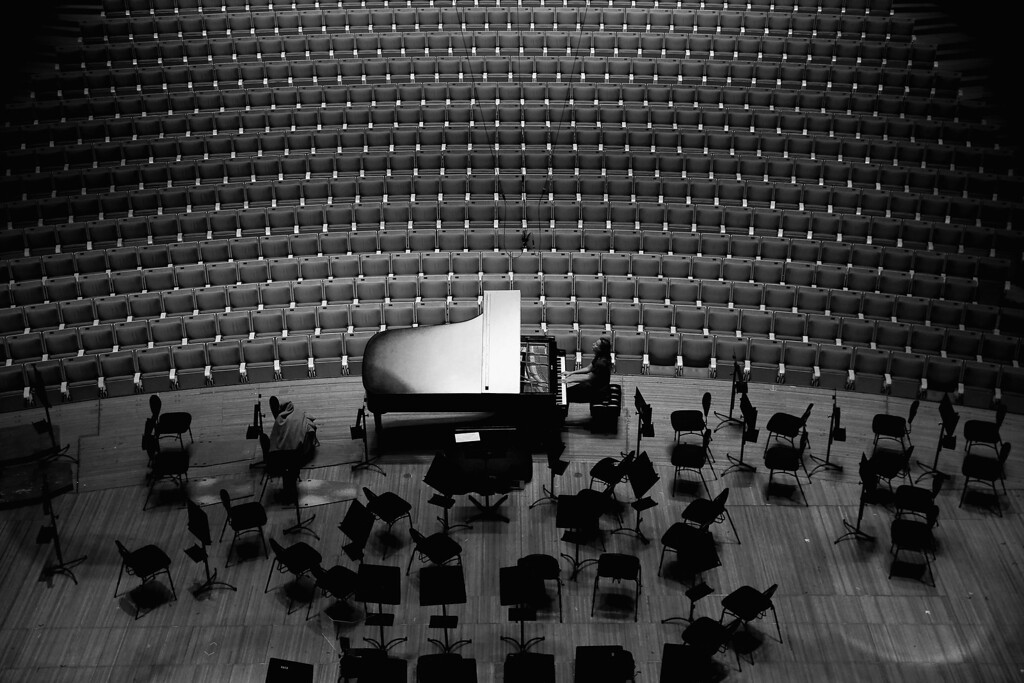 . A pianist rehearses on a grand piano in the concert hall at the Sydney Opera House on September 20, 2013 in Sydney, Australia.  (Photo by Cameron Spencer/Getty Images)