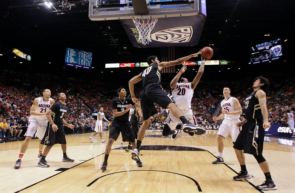 . Colorado\'s Josh Scott (40) blocks a shot by Arizona\'s Jordin Mayes in the second half during a Pac-12 men\'s tournament NCAA college basketball game, Thursday, March 14, 2013, in Las Vegas. Arizona won 79-69. (AP Photo/Julie Jacobson)