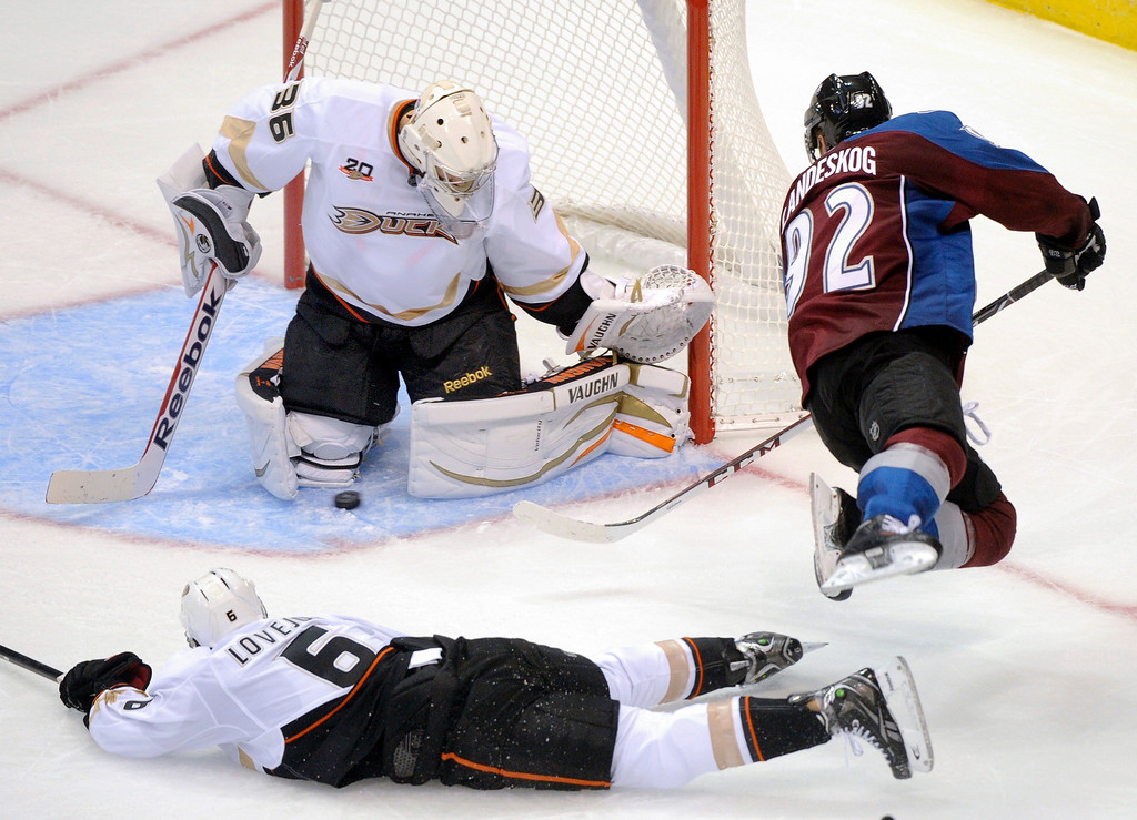 . Colorado wing Gabriel Landeskog (92) tried to slip a shot past Anaheim goalie John Gibson (36) in the second period Wednesday night. The Colorado Avalanche hosted the Anaheim Ducks in a pre-season NHL game at the Pepsi Center Wednesday night, September 18, 2013.  Photo By Karl Gehring/The Denver Post