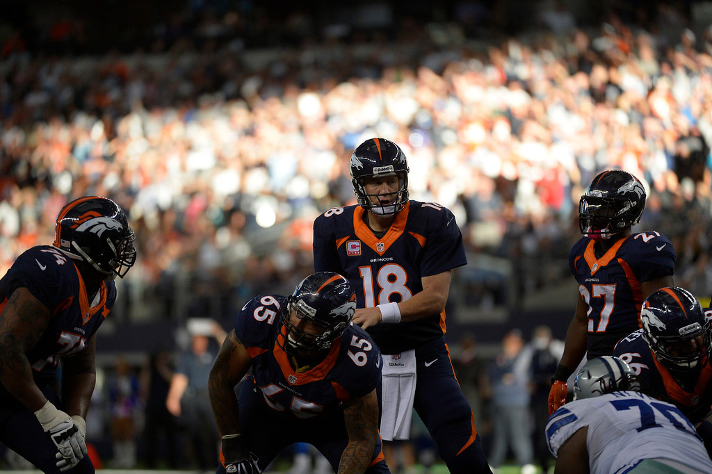 . ARLINGTON, TX. - October 06: Quarterback Peyton Manning #18 of the Denver Broncos calling a play in the 4th quarter vs the Dallas Cowboys in game 5 at AT&T Stadium October 06, 2013 Arlington, Texas. (Photo By Joe Amon/The Denver Post)
