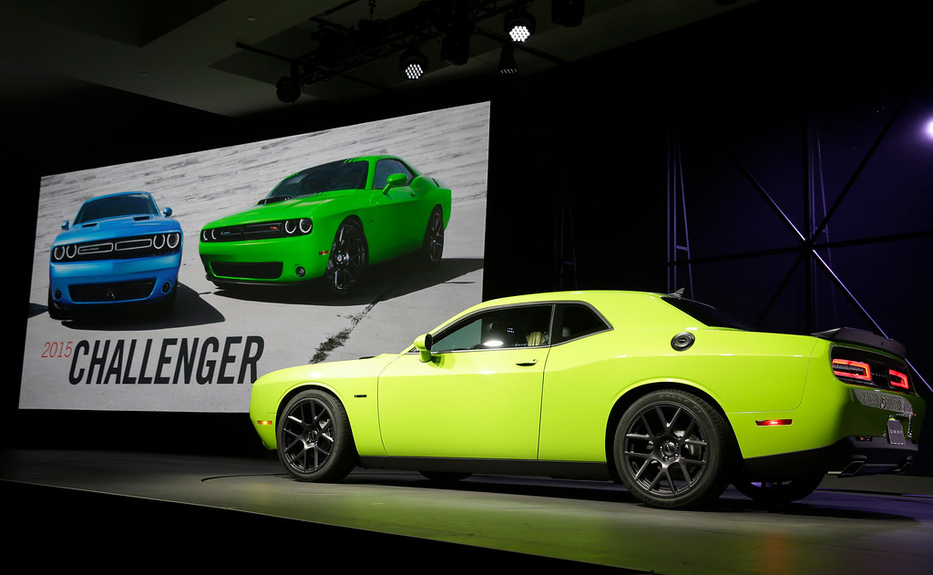 . The 2015 Dodge Challenger is introduced at the New York International Auto Show in New York, Thursday, April 17, 2014.  (AP Photo/Seth Wenig)