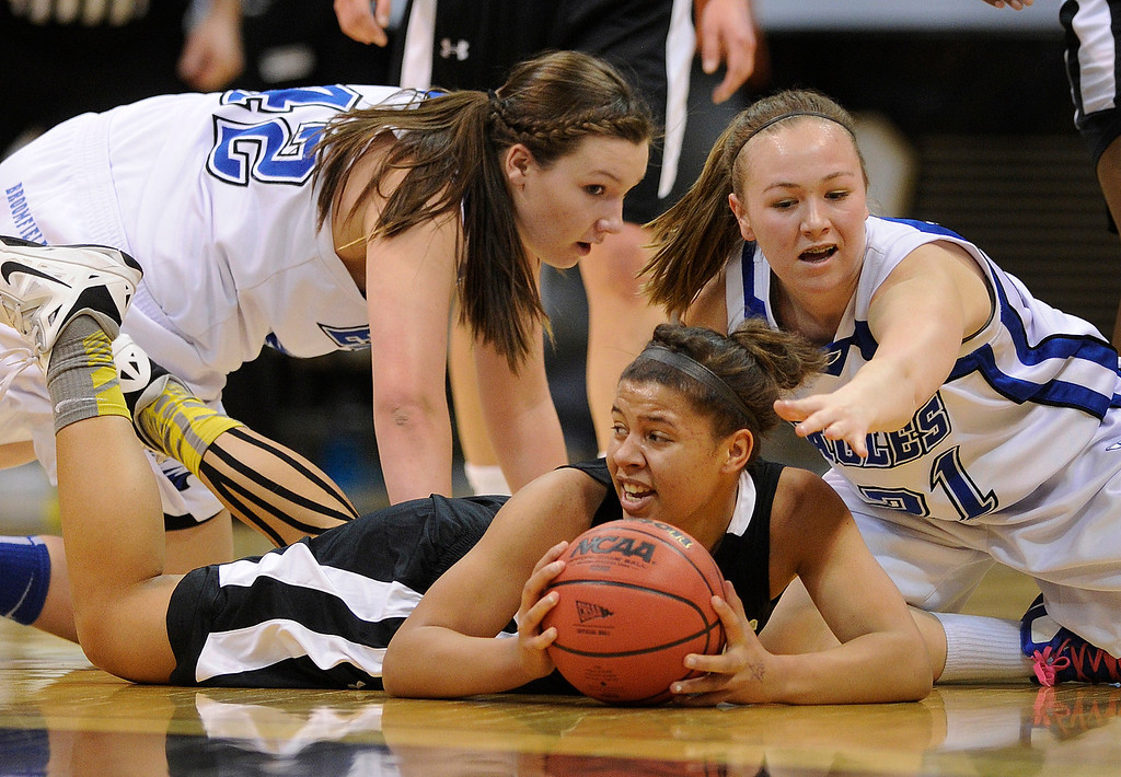 . BOULDER, CO. - MARCH 14:  Colts junior guard Shannon Patterson, center, went to the floor to collect a loose ball in the first half. The Pueblo South High School girl\'s basketball team matched up against Broomfield in a 4A playoff game staged at the University of Colorado Events Center Thursday night, March 14, 2013.  (Photo By Karl Gehring/The Denver Post)