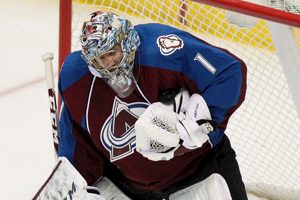 . Colorado Avalanche goalie Semyon Varlamov (1), of Russia, makes a save against the Minnesota Wild during the first period of an NHL hockey game Thursday, Jan. 30, 2014, in Denver. (AP Photo/Barry Gutierrez)