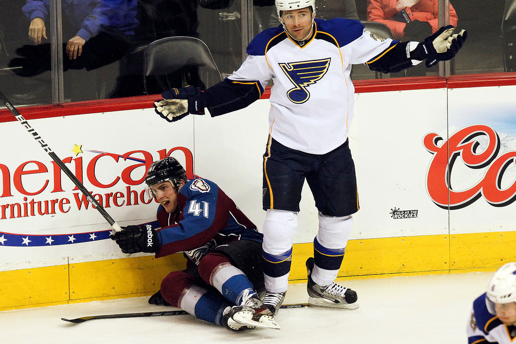 . St. Louis Blues\' Chris Porter (32) looks for a call while Colorado Avalanche\'s Tyson Barrie (41) lies on the ice during the first period of an NHL hockey game, Sunday, April 21, 2013, in Denver. The Avalanche won 5-3. (AP Photo/Barry Gutierrez)