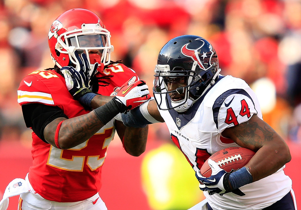 . Running back Ben Tate #44 of the Houston Texans carries the ball as free safety Kendrick Lewis #23 of the Kansas City Chiefs defends during the game at Arrowhead Stadium on October 20, 2013 in Kansas City, Missouri.  (Photo by Jamie Squire/Getty Images)