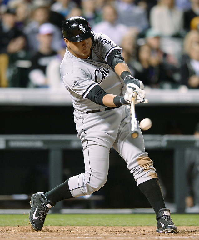 . Chicago slugger Avisail Garcia drove in a run in the eighth inning making the score 31-2. The Colorado Rockies hosted the Chicago White Sox Tuesday night, April 8, 2014 at Coors Field in Denver.  (Photo by Karl Gehring/The Denver Post)
