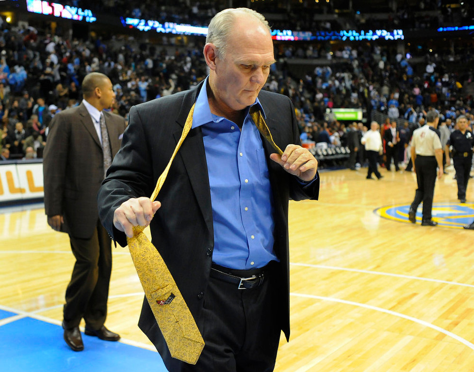 . Coach George Karl couldn\'t wait to get rid of his tie following the game.  The Denver Nuggets defeated the New Jersey Nets 107-103 at the Pepsi Center Saturday night, Nobember 20, 2010.    Karl Gehring/The Denver Post