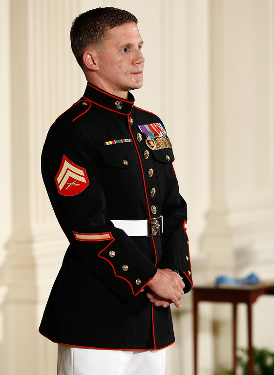 . Retired Marine Cpl. William \'Kyle\' Carpenter while being awarded the Medal of Honor from U.S. President Barack Obama during a ceremony in the East Room of the White House on June 19, 2014 in Washington, DC.  (Photo by Win McNamee/Getty Images)