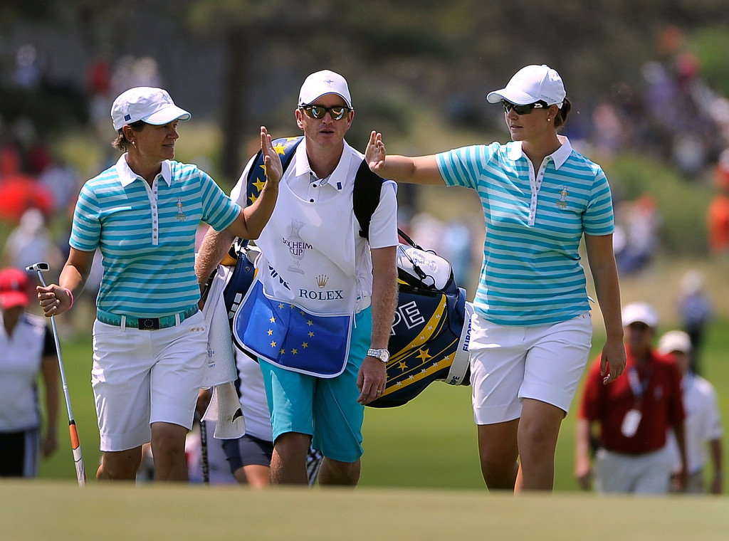 . PARKER, CO - Aug.17: Team Europe\'s Catriona Matthew, left, and Caroline Masson, right, give each other a high-five as they walk up the 18th fairway. The 2013 Solheim Cup takes place at the Colorado Golf Club with the USA taking on Europe in the Saturday morning Foursomes Match. (Photo By Kathryn Scott Osler/The Denver Post)