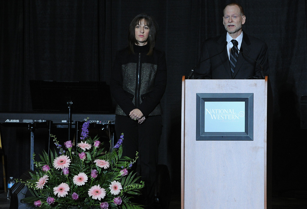 . Michael Davis, with his wife Desiree by his side, addresses a packed auditorium during the celebration of  her life memorial service held for their daughter Claire Davis at the National Western Stock Show Event Center in Denver, Co on January 1, 2014.   Claire was killed during the shooting at Arapahoe High School in Centennial in December. (Photo By Helen H. Richardson/ The Denver Post)