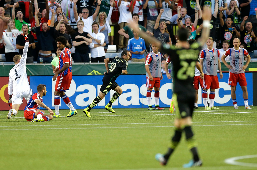 . Los Angeles Galaxy forward Landon Donovan, center rear, celebrates after he scored the go-ahead goal on Bayern Munich goalkeeper Manuel Neuer, left, in the second half of the MLS All-Star soccer game, Wednesday, Aug. 6, 2014, in Portland, Ore. The MLS All-Stars won 2-1. (AP Photo/Ted S. Warren)