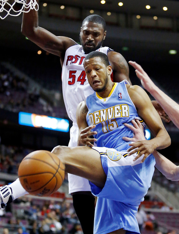 . Denver Nuggets forward Anthony Randolph (15) loses a rebound against the defense of Detroit Pistons forward Jason Maxiell (54) in the first half of an NBA basketball game, Tuesday, Dec. 11, 2012, in Auburn Hills, Mich. (AP Photo/Duane Burleson)