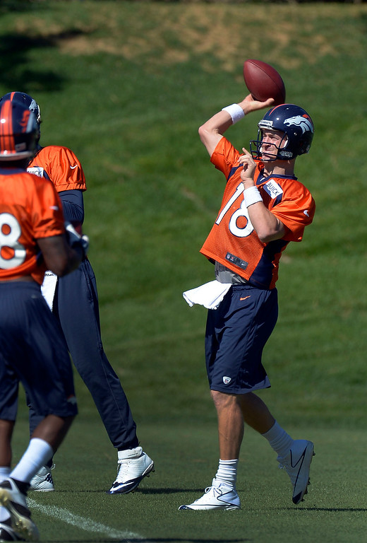. Denver Broncos quarterback Peyton Manning (18) throws a pass in drills during practice  September 3, 2013 at Dove Valley. (Photo by John Leyba/The Denver Post)