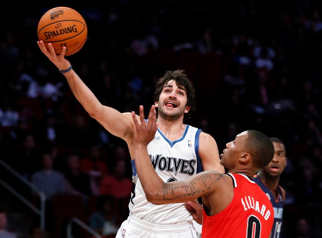 . Minnesota Timberwolves Ricky Rubio of Spain (L) shoots over Portland Trailblazers Damian Lillard during the NBA Rising Stars Challenge in Houston, Texas, February 15, 2013. The NBA All-Star basketball game will be played on February 17. REUTERS/Lucy Nicholson