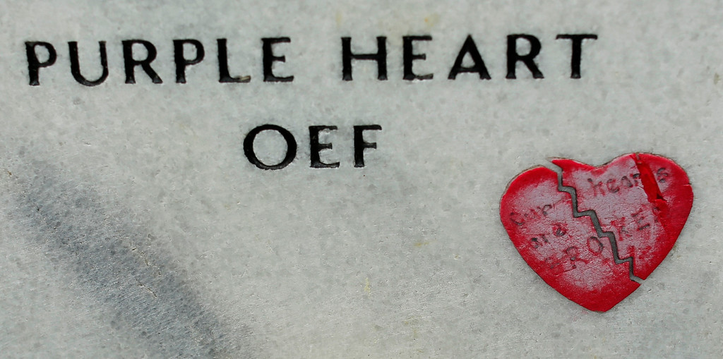 . A broken heart is seen on a headstone in Section 60 at Arlington National Cemetery in Virginia, March 13, 2013. Section 60 contains graves of soldiers from the wars in Iraq and Afghanistan. Picture taken March 13, 2013. REUTERS/Kevin Lamarque