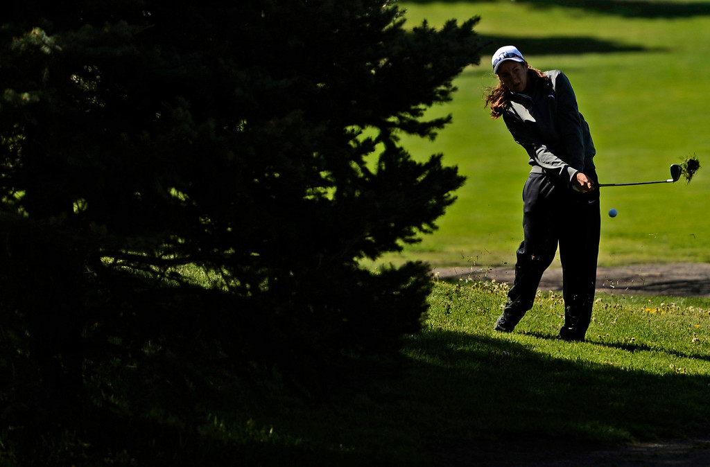 . Brooke Lucero, of Rye High School, chips on onto the green during the first round of the Colorado State Girls 4A Golf Tournament at Broken Tee Golf Course in Englewood, May 20, 2013. (Photo By RJ Sangosti/The Denver Post)