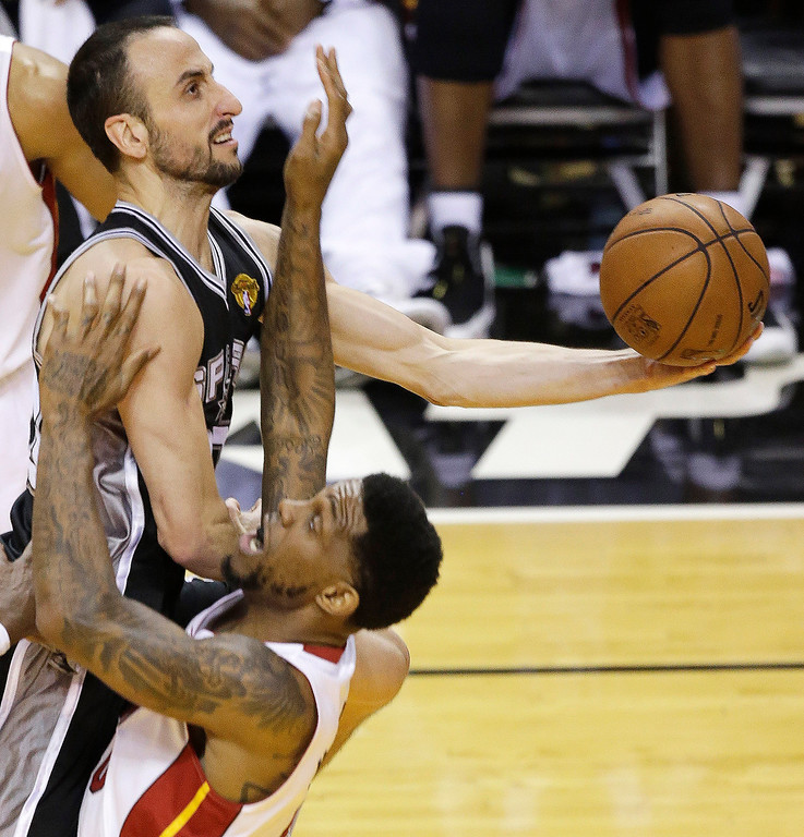. San Antonio Spurs\' Manu Ginobili (20) of Argentina, drives to the basket against the Miami Heat\'s Udonis Haslem (40) during the first half in Game 7 of the NBA basketball championships, Thursday, June 20, 2013, in Miami. (AP Photo/Wilfredo Lee)