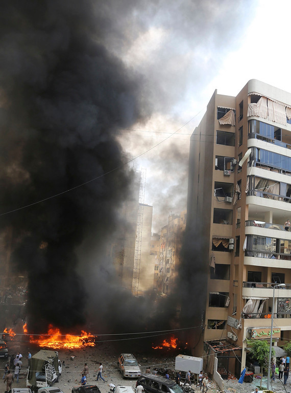 . Smoke rises from the site of an explosion in Beirut\'s southern suburbs July 9, 2013.  REUTERS/Issam Kobeisi