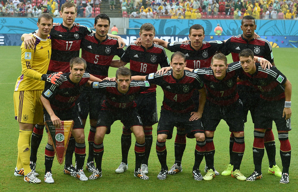. Members of the German national team pose for a picture prior to a Group G football match between US and Germany at the Pernambuco Arena in Recife during the 2014 FIFA World Cup on June 26, 2014: (front row, L-R) Germany\'s defender Philipp Lahm, Germany\'s forward Thomas Mueller, Germany\'s defender Benedikt Hoewedes, Germany\'s midfielder Bastian Schweinsteiger and Germany\'s midfielder Mesut Ozil, (row behind, L-R) Germany\'s goalkeeper Manuel Neuer, Germany\'s defender Per Mertesacker, Germany\'s defender Mats Hummels, Germany\'s midfielder Toni Kroos, Germany\'s forward Lukas Podolski and Germany\'s defender Jerome Boateng.    AFP PHOTO / NELSON ALMEIDANELSON ALMEIDA/AFP/Getty Images