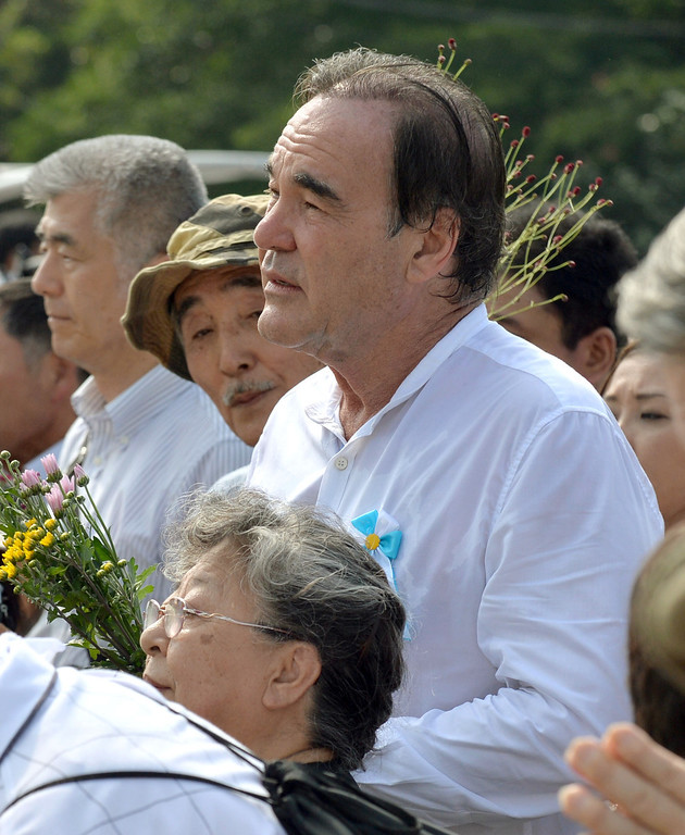 . U.S. film director Oliver Stone, center front, attends the ceremony to mark the 68th anniversary of the atomic bombing of Hiroshima at the Hiroshima Peace Memorial Park, western Japan, Tuesday, Aug. 6, 2013. (AP Photo/Kyodo News)