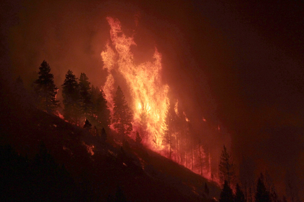 . A back burn takes hold to combat the 111,000 acre Elk Complex Fire, on Wednesday, Aug. 14, 2013 near Pine, Idaho.   (AP Photo/Times-News, Ashley Smith)