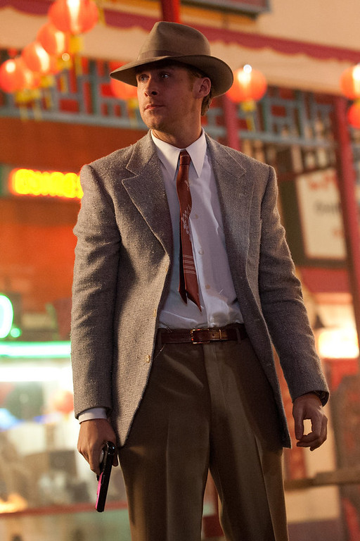 """. This film image released by Warner Bros. Pictures shows Ryan Gosling as Sgt. Jerry Wooters in \""""Gangster Squad.\"""" (AP Photo/Warner Bros. Pictures, Jamie Trueblood)"""