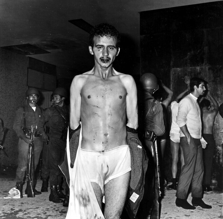 . University student Florencio Lopez Osuna, badly beaten, poses for an unknown photographer inside an apartment building in Tlatelolco, Mexico City, in this Oct. 2, 1968 photo. A Mexican magazine published photos, including the one shown, showing that paramilitary forces hired to provide security during the 1968 Olympic games apparently participated in a massacre of student protesters _ something past Mexican governments have denied. (AP Photo/Proceso)