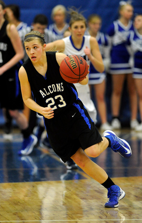 . PARKER, CO. - FEBRUARY 15: Falcons guard Shelby Hickey (23 advanced the ball in the second half. The Highlands Ranch High School girls\'s basketball team defeated Legend 76-31 Friday night, February 15, 2013. Falcon\'s coach Caryn Jarocki earned her 500th career win. (Photo By Karl Gehring/The Denver Post)