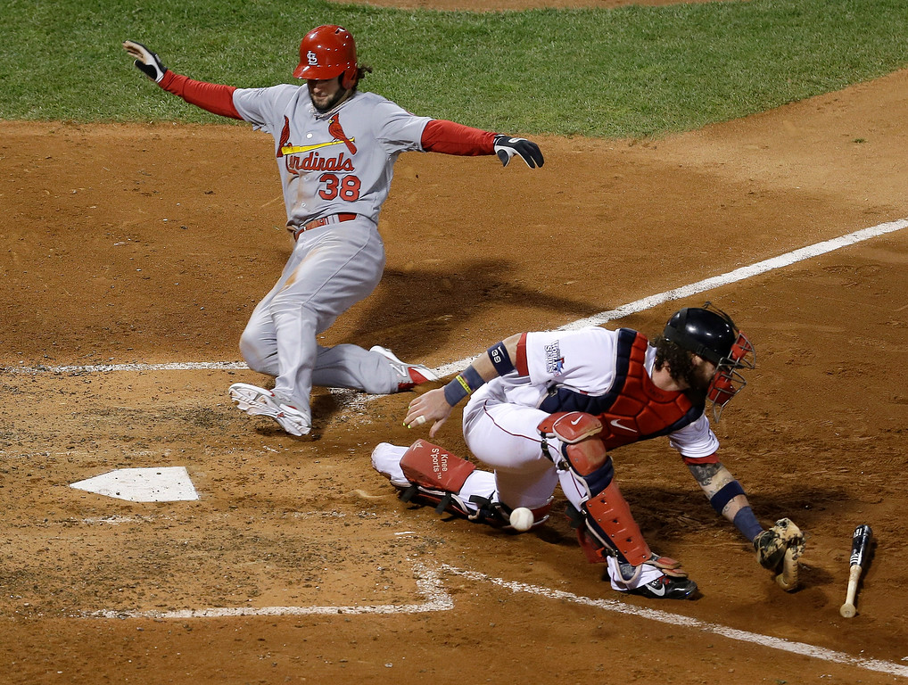 . St. Louis Cardinals\' Pete Kozma is safe at home as Boston Red Sox catcher Jarrod Saltalamacchia can\'t handle the throw during the seventh inning of Game 2 of baseball\'s World Series Thursday, Oct. 24, 2013, in Boston. (AP Photo/David J. Phillip)