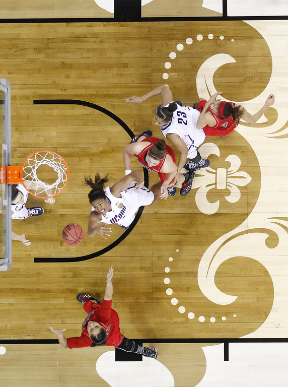 . Connecticut forward Kaleena Mosqueda-Lewis (23) goes after a rebound during first half of the national championship game against Louisville at the women\'s Final Four of the NCAA college basketball tournament, Tuesday, April 9, 2013, in New Orleans. (AP Photo/Gerald Herbert)