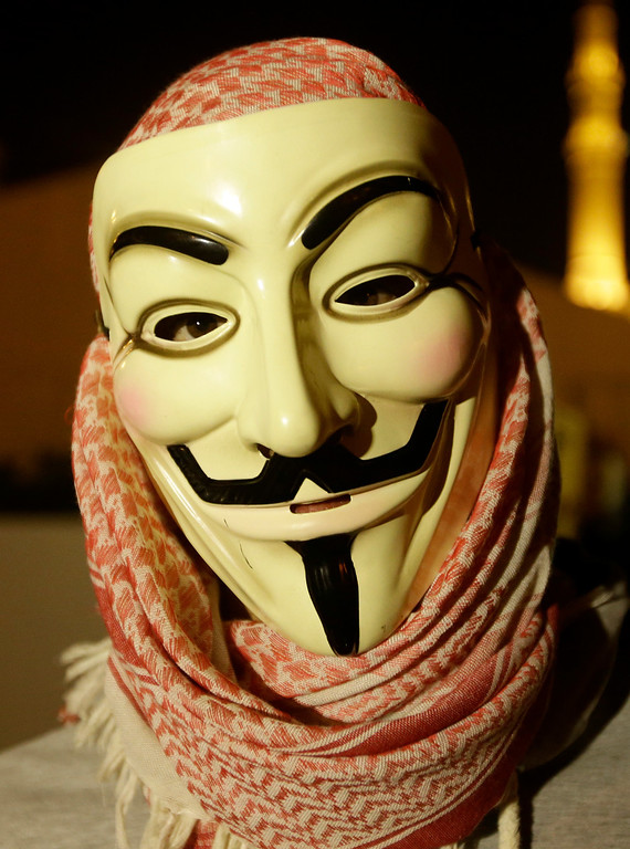. A Lebanese activist wears a mask as he protest against corrupt governments and corporations, in support of the anonymous activist moment, at the Martyrs square, in downtown Beirut, Lebanon, Tuesday, Nov 5, 2013, as part of a Million Mask March of similar rallies around the world on Guy Fawkes Day. (AP Photo/Hussein Malla)