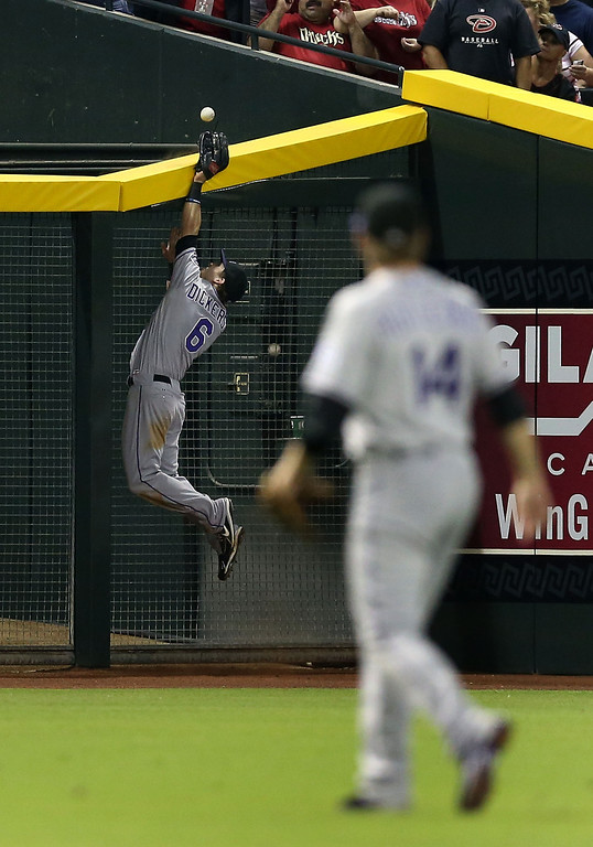 . PHOENIX, AZ - JULY 05:  Outfielder Corey Dickerson #6 of the Colorado Rockies attempts to make a leaping catch on a double hit by A.J. Pollock (not pictured) of the Arizona Diamondbacks during the third inning of the MLB game at Chase Field on July 5, 2013 in Phoenix, Arizona.  (Photo by Christian Petersen/Getty Images)