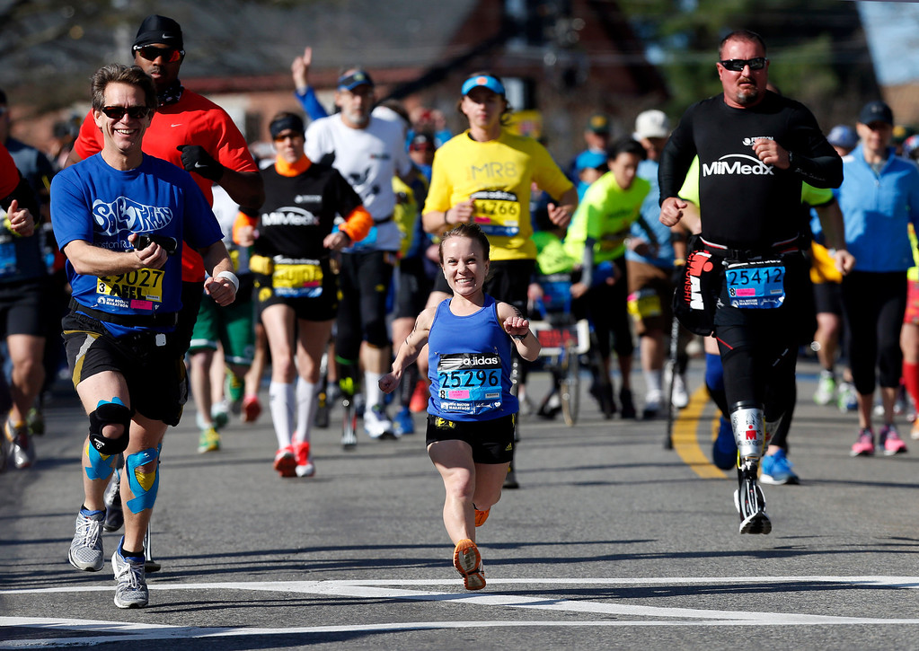 . Mobility-impared runners David Abel, left, Juli Windsor, and Scott Rigsby compete in the 118th Boston Marathon Monday, April 21, 2014 in Hopkinton, Mass. (AP Photo/Michael Dwyer)