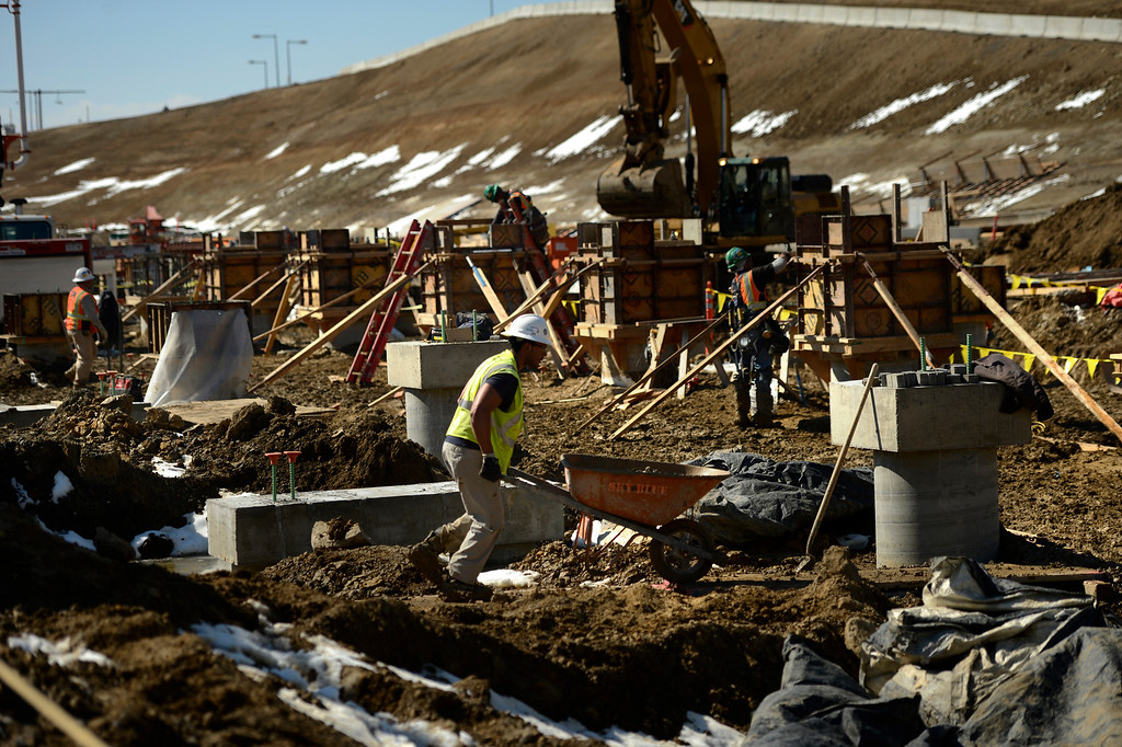 . Construction workers building forms for the Canopy Caissons where the trains will head to the station at the Denver International Airport South Terminal Redevelopment Program is now starting to build vertical as the train station and the Westin Hotel and conference center are beginning to take shape. March 27, 2013 Denver, Colorado. (Photo By Joe Amon/The Denver Post)