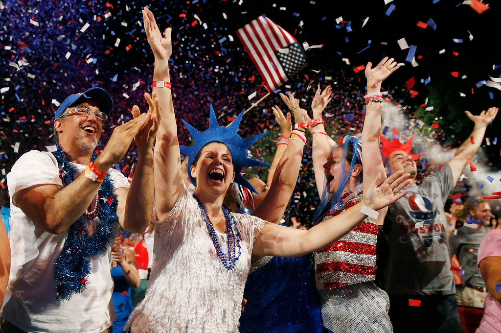 . A crowd celebrates during the finale of the Boston Pops Fourth of July Concert at the Hatch Shell in Boston, Thursday, July 4, 2013. (AP Photo/Michael Dwyer)