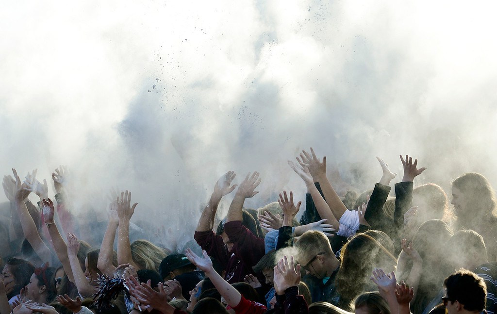 . Silver Creek students throw white powder into the air at the beginning of the third quarter against Coronado during the Class 3A state championship game Saturday Nov. 30, 2013 at Everly-Montgomery Field.  (Lewis Geyer/Times-Call)