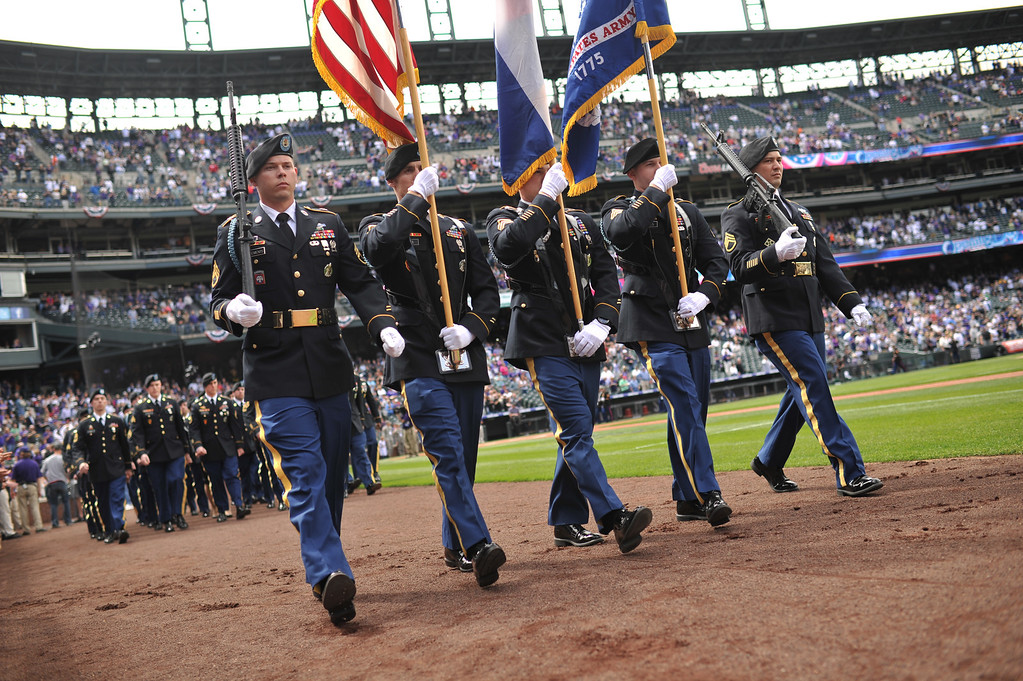 . The colors are carried onto the field before the National Anthem.  (Photo by Hyoung Chang/The Denver Post)